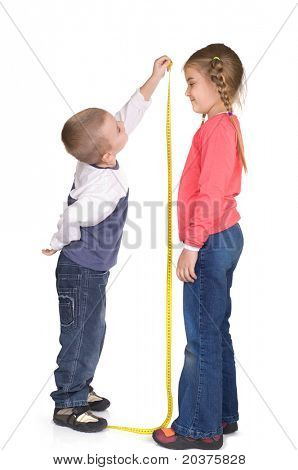 children are playing and measuring height