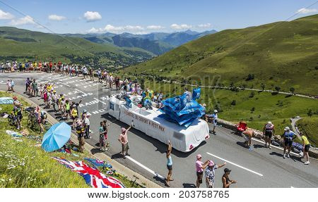 Col de PeyresourdeFrance- July 23 2014: Ibis Budget vehicle passing in the Publicity Caravn on the road to Col de Peyresourde in Pyrenees Mountains during the stage 17 of Le Tour de France 2014. Ibis Budget Hotel is an international chain of cheap hotels.