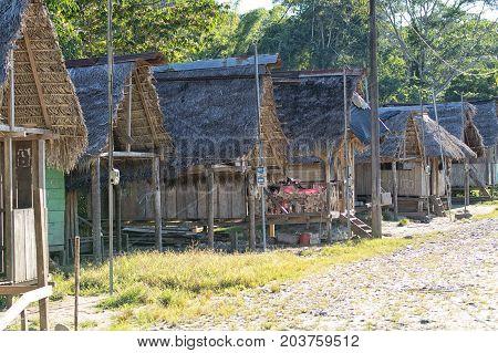 June 6 2017 Misahualli Ecuador: row of small habitation shacks made of wood planks in the Amazon area