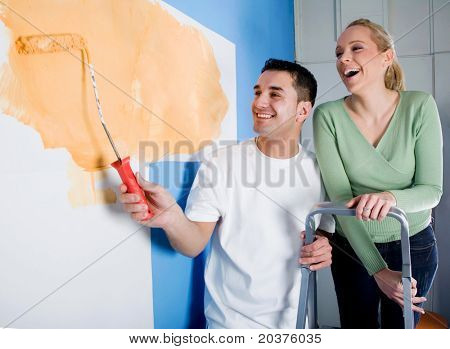 young couple in love redecorating new home