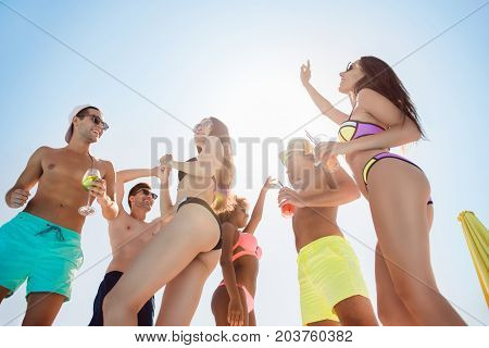Party All Day! Go Crazy Non Stop. Low Angle Photo Of Six Excited Multi National Tourists, Enjoying A