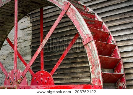 The idle water wheel on the side of a Wisconsin mill.