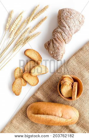 baking fresh wheaten bread on bakery work table white background top view