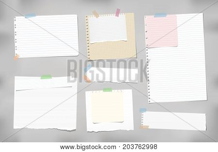 Torn ruled, blank, squared note, notebook, copybook paper strips, sheets stuck with colorful sticky tape on gray background