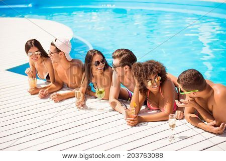 Six Friendly Multi Ethnic Hot Teens In Diverse Swim Wear And Spectacles Are Chatting, Standing In Th