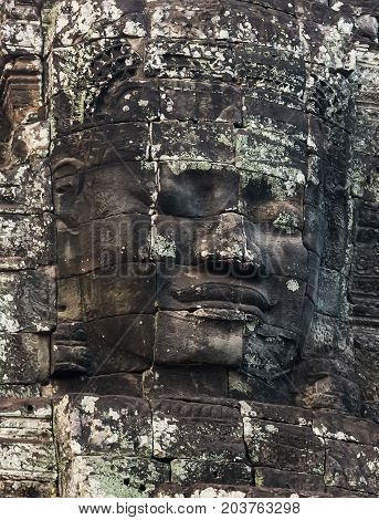 Stone smiling Faces of king Bayon Temple Angkor Thom Cambodia. Ancient civilization monument Khmer architecture Kampuchea.