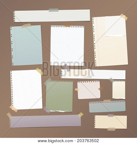 Ruled, squared note, notebook, copybook paper strips, sheets stuck with sticky tape on brown background