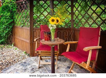 Seating area with sunflowers in the Garden Pavilion