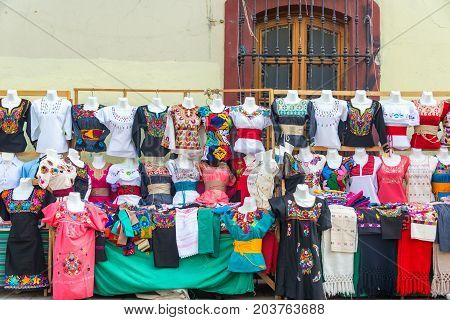 OAXACA MEXICO - MARCH 4: Outdoor stand with dresses and blouses for sale in Oaxaca Mexico on March 4 2017