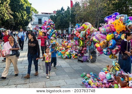 OAXACA MEXICO - MARCH 4: Balloons for sale in the Zocalo in Oaxaca Mexico on March 4 2017