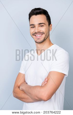 Close Up Portrait Of Successful Young Stylish Bearded Brunet In White T Shirt, Standing On Light Gre