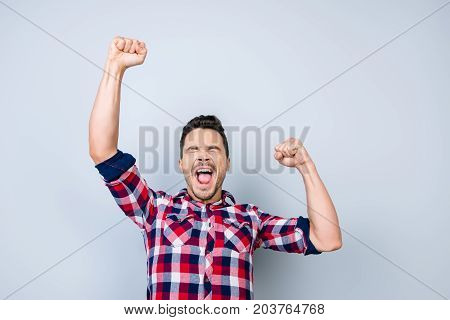 Yes! Goal! Young Cheerful Guy Is Watching The Sports Game And Is Gesturing Victory Of His Favourite