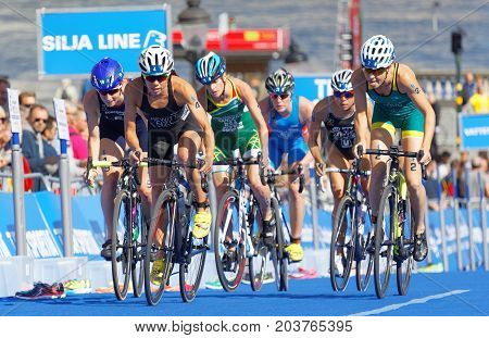 STOCKHOLM - AUG 26 2017: Group of fighting female triathlete cyclists Hewitt Sanders Gentle and competitors in the Women's ITU World Triathlon series event August 26 2017 in Stockholm Sweden