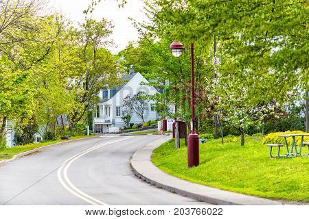 Landscape View Of Chemin Royal Road In Ile D'orleans, Quebec, Canada During Sunset In Small Village