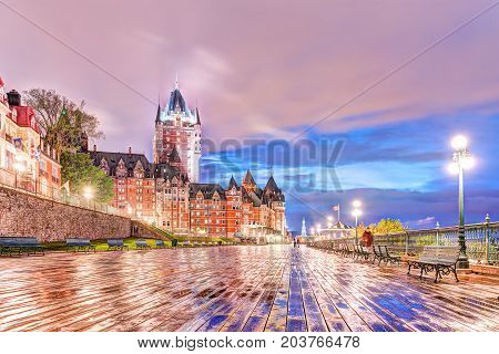 Quebec City, Canada - May 30, 2017: Closeup Of Old Town Ground Level View Of Wet Dufferin Terrace Bo