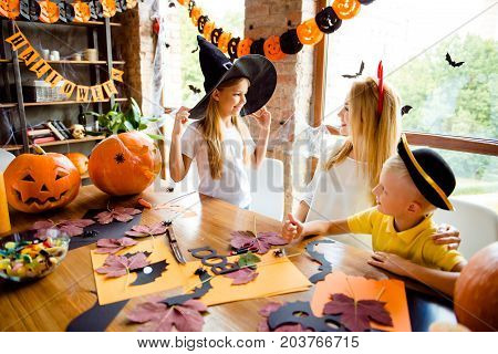 Getting Ready For The Halloween Costume Party, Blond Mother With Two Small Cheerful Kids, Girl Holds