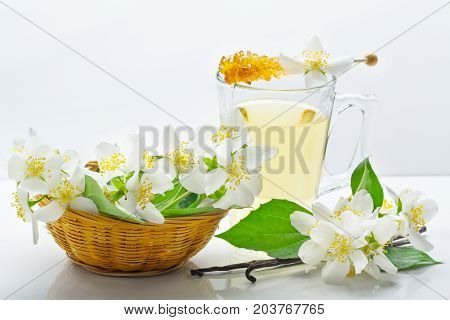 Jasmine tea jasmine flowers in the basket and vanilla