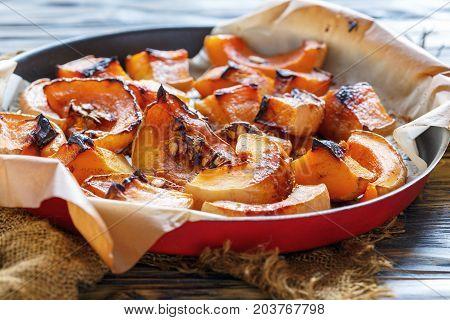 Pieces Of Baked Pumpkin On A Sheet Of Parchment.