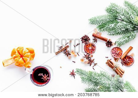 Ingredients of hot mulled wine or grog set with spices and citrus for winter evening. Christmas and new year eve. White background top view. Space for text