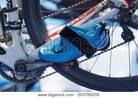STOCKHOLM - AUG 26 2017: Triathlon cycle with a fastened shoe in the Women's ITU World Triathlon series event August 26 2017 in Stockholm Sweden