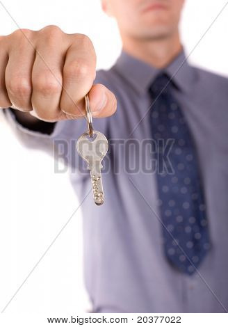 agent holding a key of a new home