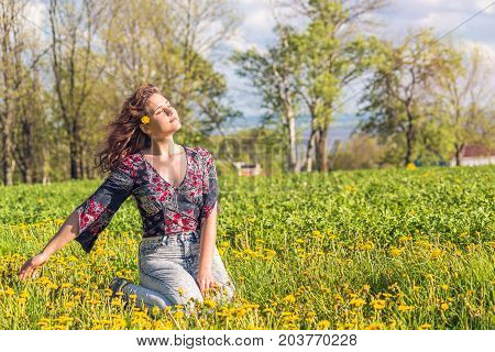 Portrait Of Young Smiling Woman Sitting In Yellow Dandelion Farm Field During Sunset In Ile D'orlean