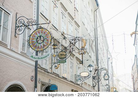 Austria, Salzburg, January 1, 2017: Advertising signs of shops on Getreidegasse street. A picturesque street in the old town.