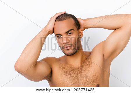 Confident Andsome Young Mulatto Nude Man Is Standing On The Pure White Background, Fixing His Perfec