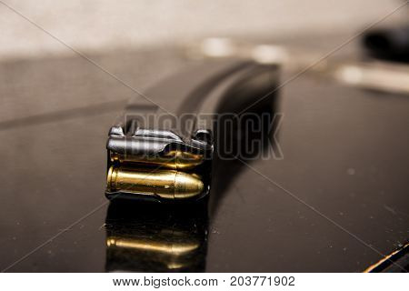 Clip Of Ammunition. Cartridges In Holder Close Up.