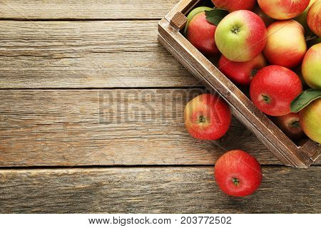 Ripe Apples In Crate On Grey Wooden Table