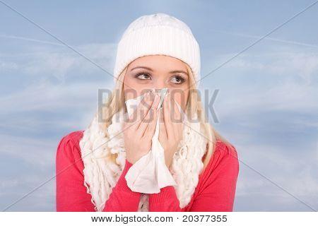 sick woman sneezing or having flu