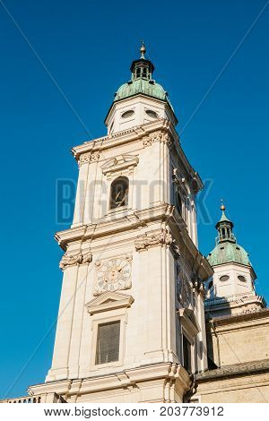 Part of the facade of the Salzburg Cathedral, one of the most notable and picturesque sights of the city. The majestic facade of the building is made in the architectural style of the early Baroque.