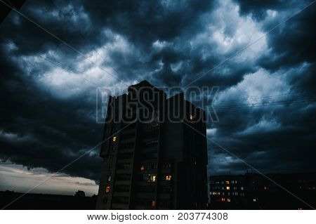 Storm clouds a hurricane is coming. Beautiful storm sky with clouds over the city apocalypse like