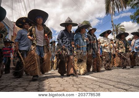 June 25 2017 Cotacachi Ecuador: indigenous quechua men wearing sombreros and chaps at the Inti Raymi celebrations