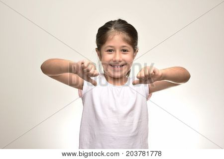 smart girl holding her hands and showing herself
