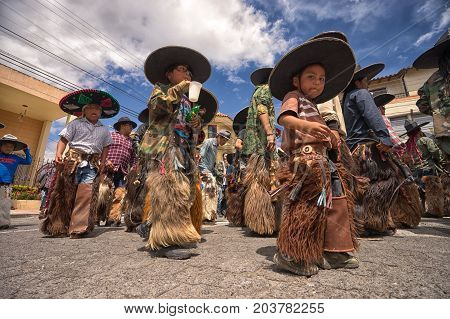 June 25 2017 Cotacachi Ecuador: all ages are represented at the Inti Raymi parade in the indigenous kichwa town