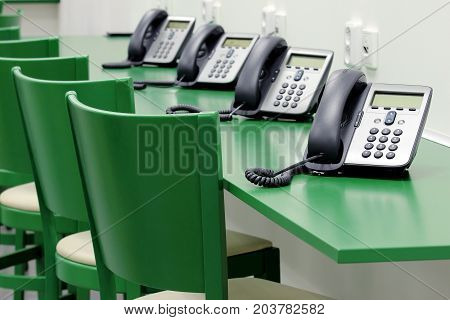 detail of green call center with ip phones