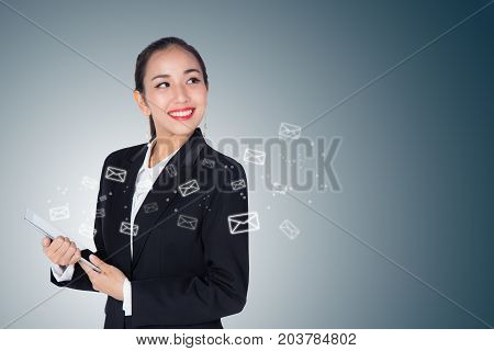 Businesswoman Receive And Sending Email By Digital Tablet On Blue Background.