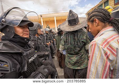 June 25 2017 Cotacachi Ecuador: police closing off access to a street during Inti Raymi parade to separate the male dancer groups and avoid violence between them