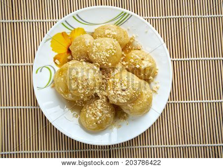 poster of Loukoumades Greek pastry made of deep fried dough soaked in sugar syrup or honey and cinnamon.found in the Mediterranean Middle East and South Asia from the Italian
