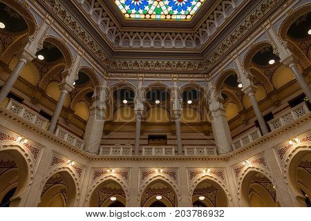SARAJEVO BOSNIA AND HERZEGOVINA - APRIL 16 2017: Interior of the main hall of the Vijecnica the former library and city hall of Sarajevo destroyed during the 1991-1995 conflict and reconstruted characterized by its ottoman style