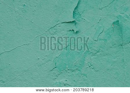 Wall with old exfoliating paint mint color