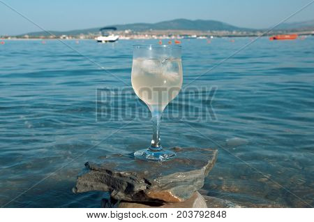 Glass Of White Wine By The Coast
