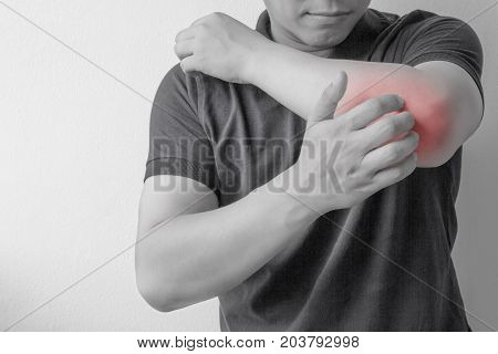 Young man scratch the itch on his arm