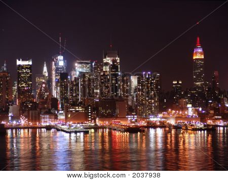 Night time skyline shot of New York City. poster