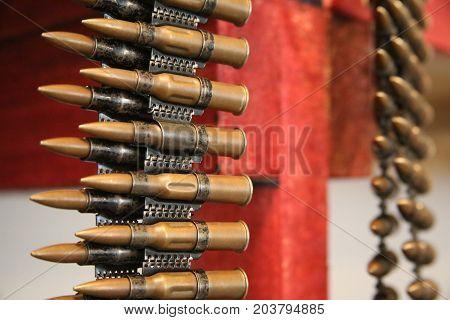 Cartridges in machine-gun belt Close-up view of few items