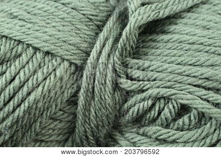 A super close up image of forest green yarn