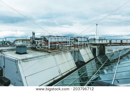 The roof of a modern building, glass ceilings and ventilation system, toned