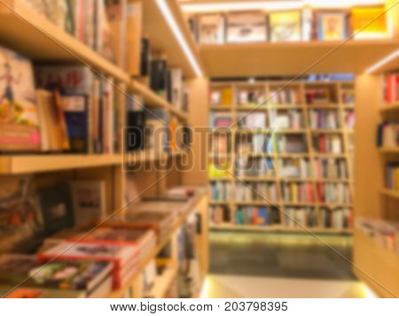 Vintage style color tone . Blur image of a bookstore .