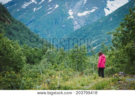 Tourist Woman Enjoying Mountains Landscape In Norway.